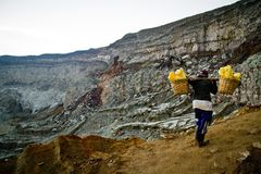 A sulpher miner of Ijen volcano, Ijen, Indonesia Stock Photo