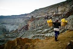 A sulpher miner of Ijen volcano, Ijen, Indonesia Stock Photo