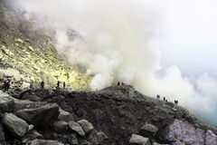 Sulphur miner in Ijen. In Indonesia stock images