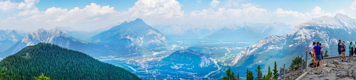 Sulphur Mountain in Canadian Rockies of Banff National Park. BANFF, CANADA - AUG 1, 2018: Visitors enjoying a panoramic view of the mountain range in the stock photos
