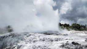 Sulphur and silica geothermal deposits and Pohutu geyser. Yellow sulphur geothermal deposits and Pohutu Geyser. Rotorua - travel destination in central North royalty free stock photos
