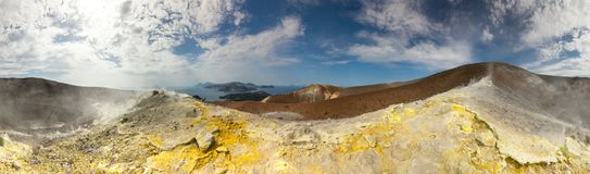 Sulphur on the surface of old vulcan with amazing view over islands stock photos