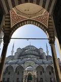 Sultan Ahmed Mosque. A popular tourist site, the Sultan Ahmed Mosque continues to function as a mosque today; men still kneel in prayer on the mosque& x27;s lush Royalty Free Stock Images