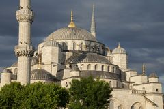 Sultan Ahmet Camii ( Blue Mosque ) glows in early evening light Stock Images