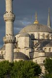 Sultan Ahmet Camii ( Blue Mosque ) glows in early evening light Royalty Free Stock Photo