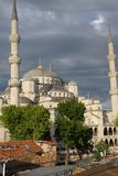 Sultan Ahmet Camii ( Blue Mosque ) glows in early evening light Royalty Free Stock Images
