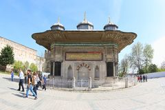 Sultan Ahmet III Fountain. The Sultan Ahmet III fountain is a fountain in a Turkish rococo structure located in the great square in front of the Imperial Gate of stock images