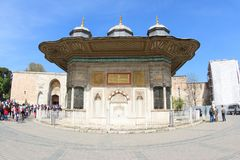 Sultan Ahmet III Fountain. The Sultan Ahmet III fountain is a fountain in a Turkish rococo structure located in the great square in front of the Imperial Gate of royalty free stock photography