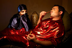 Sultan and female Royalty Free Stock Image