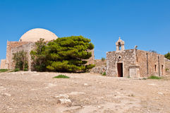 Sultan Ibrahim mosque and church of Agia Ekaterini on Crete, Greece. Rethymno city. Crete, Greece. Stock Images