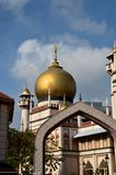 Sultan mosque through ceremonial arch, Singapore. One of Singapore's largest mosques, the Sultan Masjid, as seen through an arch created to celebrate historical royalty free stock photography