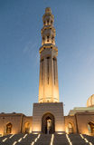 Sultan Qaboos Grand mosque at dusk. Grand architecture of minaret at Sultan Qaboos Grand mosque at dusk, Muscat, Oman Stock Photography