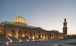 Sultan Qaboos Grand mosque at dusk. Grand architecture of minaret at Sultan Qaboos Grand mosque at dusk, Muscat, Oman Royalty Free Stock Images