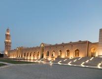 Sultan Qaboos Grand mosque at dusk. Grand architecture of minaret at Sultan Qaboos Grand mosque at dusk, Muscat, Oman Stock Photo