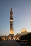 Sultan Qaboos Grand mosque at dusk. Grand architecture of minaret at Sultan Qaboos Grand mosque at dusk, Muscat, Oman Stock Photos