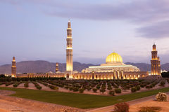 Sultan Qaboos Grand Mosque in Muscat, Oman. The Sultan Qaboos Grand Mosque illuminated at dusk. Muscat, Oman, Middle East Stock Photography
