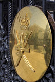 The Sultan's coat of arms and reflections on a brass shield in O Stock Images