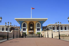 The Sultan's Palace and flag in Old Muscat Stock Photo