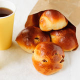 Sultana Buns in a Paper Bag with a Cup of Coffee. Raisin Buns in a Paper Bag with a Cup of Coffee Stock Photography