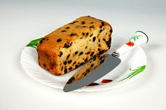 Sultana fruitcake and knife. Stock Photography