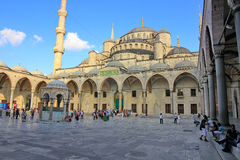 Sultanahmet Courtyard. ISTANBUL - JUL 15: Tourists visit Blue Mosque on July 15, 2013 in Istanbul. It was built from 1609 to 1616, during the rule of Sultan Stock Photography