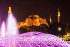 Sultanahmet fountain and Hagia Sophia by night Royalty Free Stock Photos