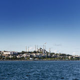 Sultanahmet Mosque. Sultanahmet (the Blue Mosque) under a blue sky and cloudscape in the background, taken from the sea Royalty Free Stock Image