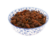 Sultanas in a blue and white china bowl Royalty Free Stock Photo