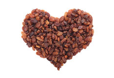 Sultanas in a heart shape Stock Photography