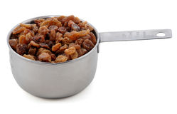 Sultanas presented in an American metal cup measure Royalty Free Stock Photos