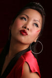 Sultry asian looking over shoulder Royalty Free Stock Images