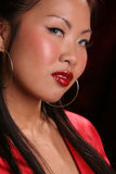 Sultry asian racing right Royalty Free Stock Photography