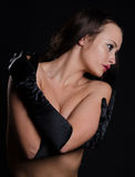 Sultry, topless, modest beauty wearing opera glove Royalty Free Stock Photos