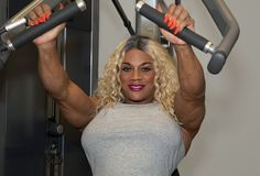 Kim Buck, Enticing Woman Bodybuilder Works Out. Sultry female professional bodybuilder Kim Buck from Georgia, is doing some upper-body work in the gym. Still stock images