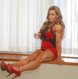 Sultry, Glamorous, and Athletic. Brazilian fitness model and Ms Olympia Physique champion, Juliana Malacarne, displays some impressively defined curves, making Royalty Free Stock Image
