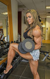 Sultry, Glamorous, Curls. Brazilian fitness model and Ms Olympia Physique champion, Juliana Malacarne, displays some impressively defined curves, as she pumps Royalty Free Stock Photography