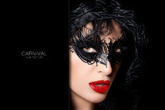 Sultry mysterious woman in carnival mask Royalty Free Stock Photography