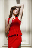 Sultry portrait of brunette in a red dress Stock Photos