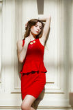 Sultry portrait of sexy brunette in a red dress Stock Photos