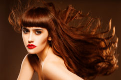Sultry redhead with hair flying Stock Images
