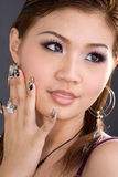 Sultry vixen painted nails. Close up of young smiling woman with painted fingernails Royalty Free Stock Photo