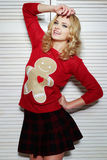 Sultry Woman in Red Sweater Royalty Free Stock Photo