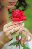 Sultry woman with single red rose Royalty Free Stock Photos