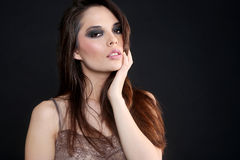 Sultry Young Woman on a Simple Background Royalty Free Stock Images