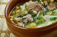 Sulu khingal. Mutton soup with noodles and chickpeas, Azerbaijan cuisine royalty free stock images