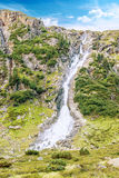 Sulzenaufall waterfall, mountains and peaks. Hiking in the Stubai Alps royalty free stock image