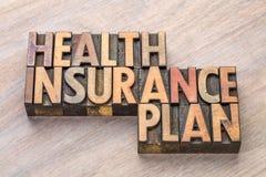 Sumário da palavra do plano do seguro de saúde no tipo de madeira Fotografia de Stock Royalty Free