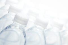 Sumário das garrafas de água Fotografia de Stock Royalty Free