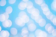 Sumário de luzes de Bokeh contra um fundo azul Imagem de Stock Royalty Free