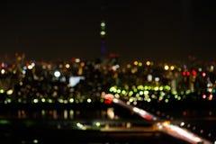 Sumário do fundo da luz da cidade do borrão Foto de Stock Royalty Free
